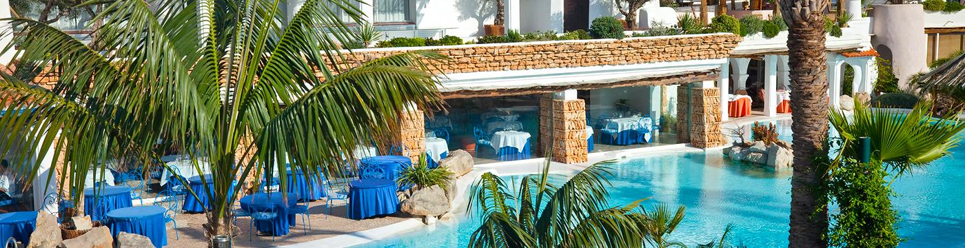 Фотография отеля Hacienda Na Xamena рестораны и бассейн - Испания Ибица