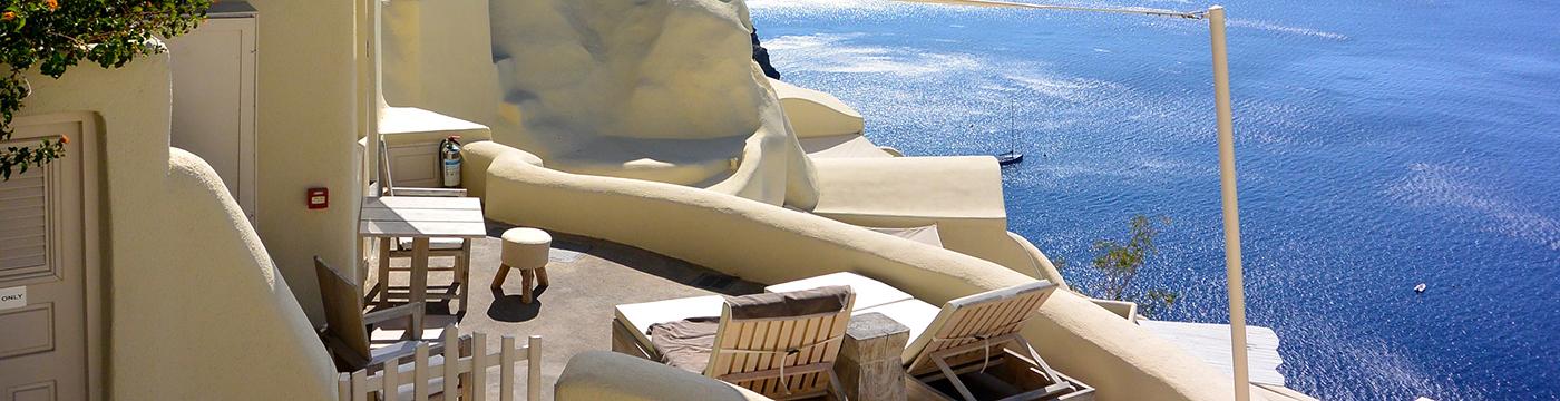 Фотография отеля Mystique, A Luxury Collection Hotel отель в белом камне - Греция, Санторини